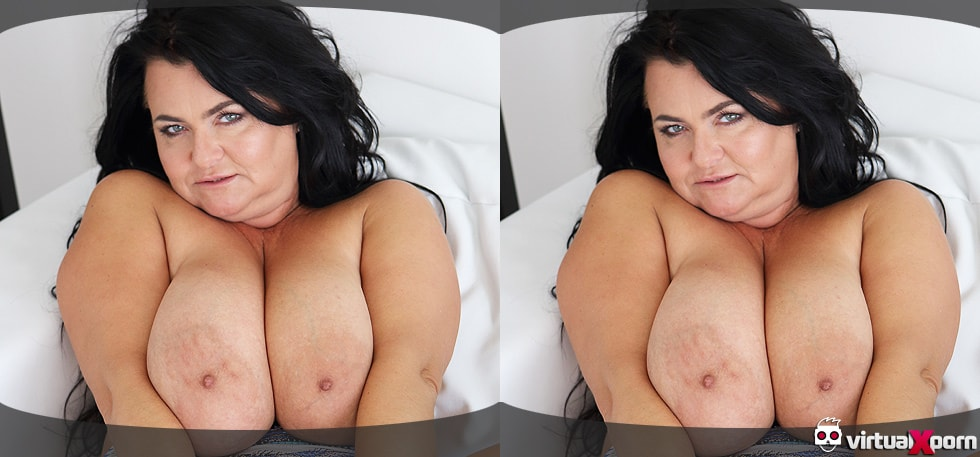 Busty Reny shows her gigantic boobs